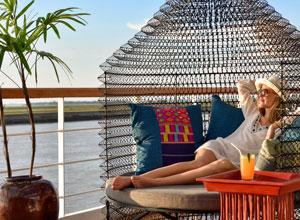 Relax with a drink on Sanctuary Ananda as you cruise along the Irrawaddy River