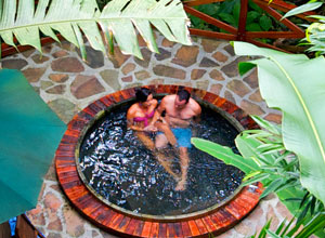 Relax in a jacuzzi at Nayara Hotel Spa and Gardens