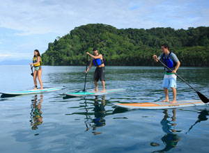 Test your balance with some paddle boarding at Playa Cativo